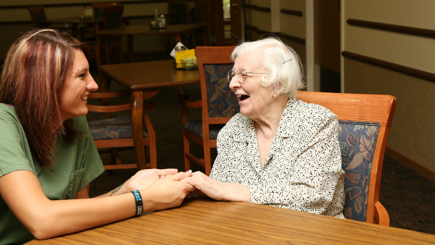 Staff And Resident Share Laughter