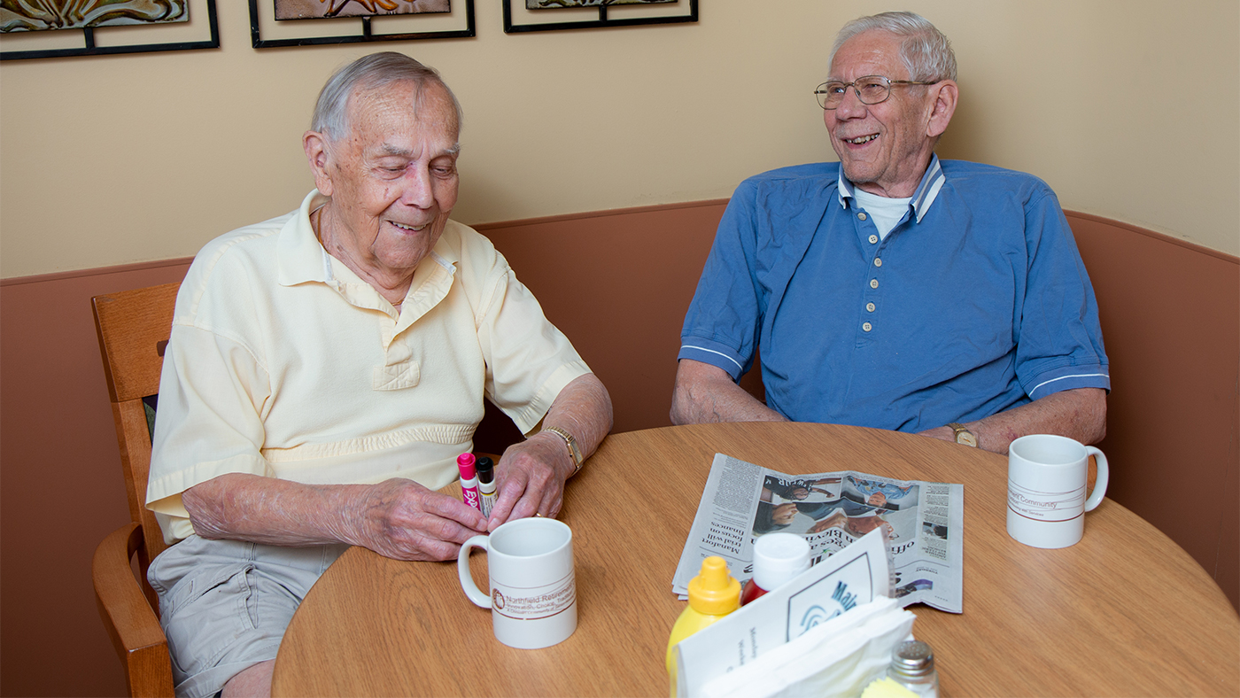 Two Residents Enjoying Coffee